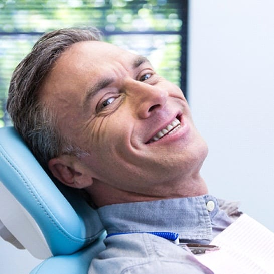 Man smiling after advanced dental implant procedure in Richardson