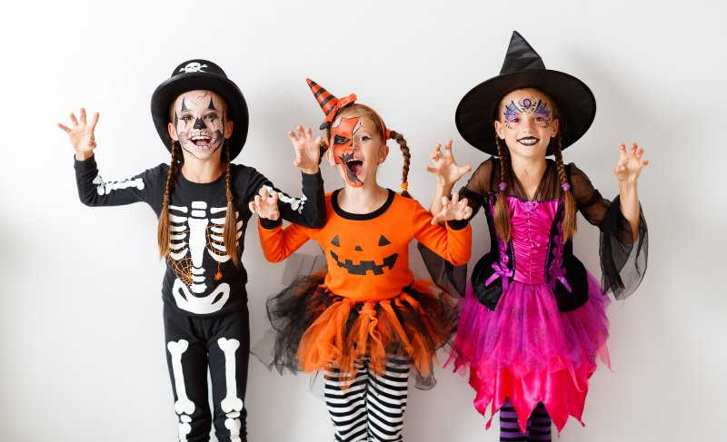 group of children in costumes on Halloween